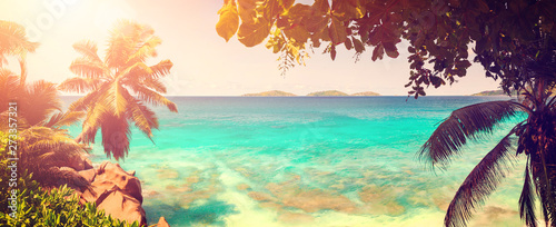 Palm and tropical sea beach panorama vintage style tone. Anse Source d'Argent, La Digue island. Seychelles