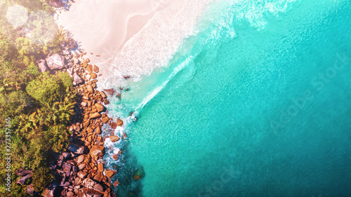 Poster Turquoise Tropical beach with sea and palm taken from drone. Seychelles famous shark beach - aerial photo