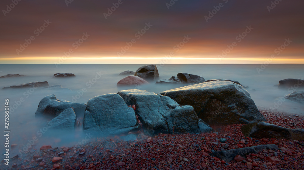 Fototapety, obrazy: Beautiful sunrise in the Lake Superior lake shore beach with rocks long exposure