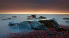 Beautiful Sunrise In The Lake Superior Lake Shore Beach With Rocks Long Exposure