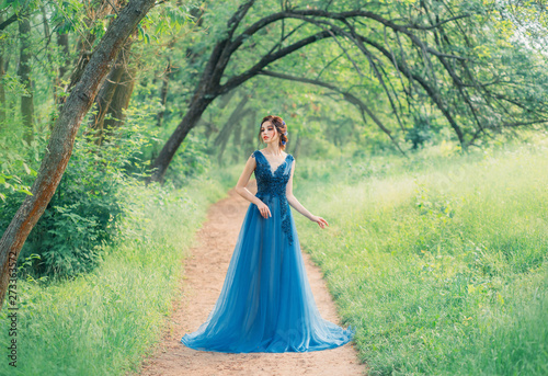 Fototapeta incredible cute sea princess walks through a red fairy forest alone, a magic fai