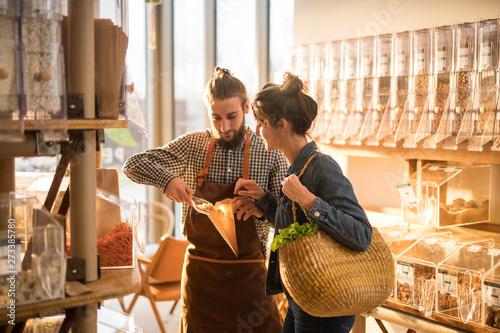 Fotografie, Obraz  Beautiful young woman shopping in a bulk food store