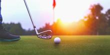 Golf Balls And Golf Club On Gr...