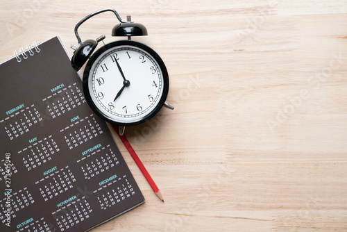 close up of alarm clock, pencil and calendar on the table, planning for business Wallpaper Mural