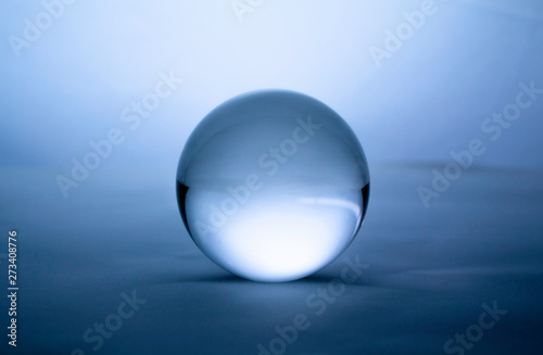 Crystal glass ball sphere transparent on blue gradient background Canvas Print