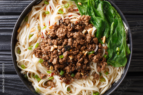Dan Dan Noodles - Savory and spicy Sichuan noodles served with ground meat closeup on the plate Fototapeta