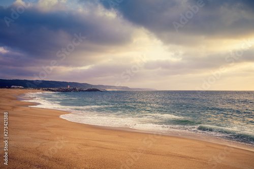 Foto auf Leinwand Texturen Sunset over the sea. Atlantic ocean in the evening. Nazare, Portugal, Europe