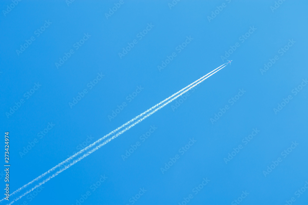 Fototapety, obrazy: jet airplane flying at high altitude with contrails on beautiful blue sky