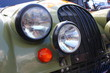 two headlights of a vintage car