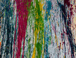 paint of different colors spilled on a vertical surface