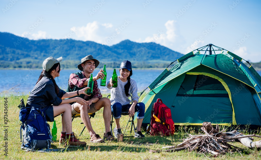 Fototapeta Camping camp in nature happy friends party and drinking beer together in summer