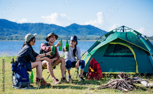 Fotografiet  Camping camp in nature happy friends party and drinking beer together in summer