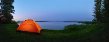 Orange Tent By The Lake