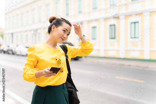 Happy tourist woman used smart phone for searching the street locations Canvas Print