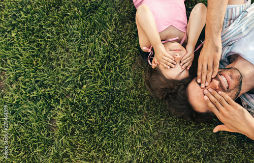 Top view image of happy handsome father and cute child playing in the park Canvas Print