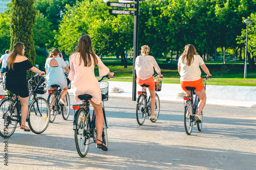 Tourist girls on the bicycles. Holidays in Spain.