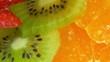 Sliced strawberry, Kiwi and Orange rotating fruit salad or fruit tart.