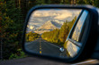 canvas print picture - Driving through a mountain road and watching the beautiful scenery in the rearview mirror in the icefields parkway near Jasper