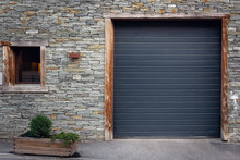 Architecture Front View Of Metal Roller Shutter Door And Window With Tile Stone Background, Antique Architectural Of Entrance Private Housing., Steel Rolling Shutter Door