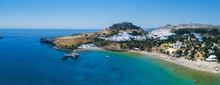 Aerial Birds Eye View Drone Photo Of Village Lindos, Rhodes Island, Greece. Beautiful Panorama With Castle, Mediterranean Sea Coast. Famous Tourist Destination In South Europe.