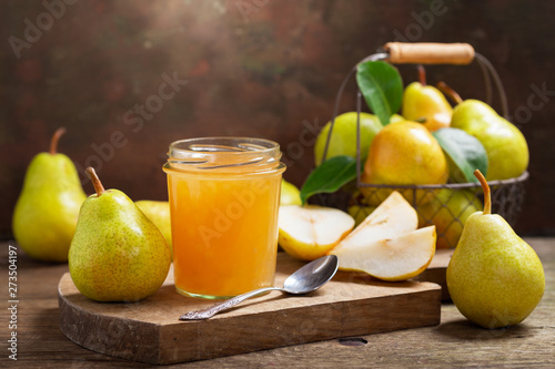 glass jar of pear jam with fresh fruits