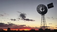 Silhouette Of A Large Windmill...
