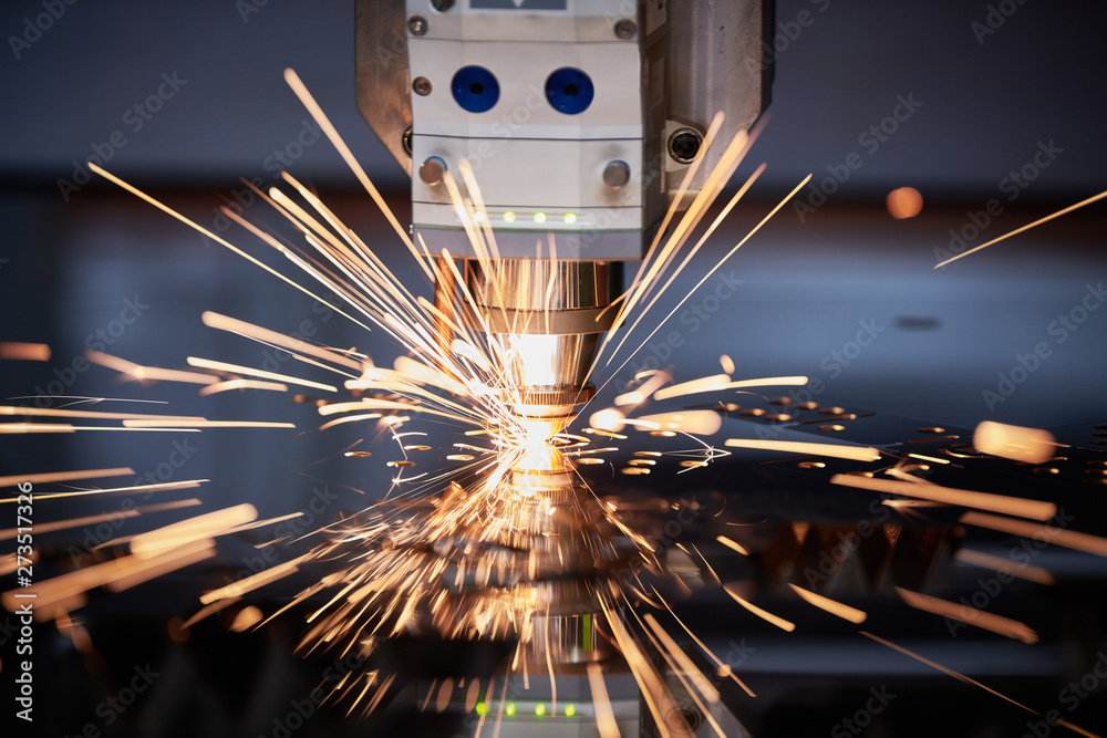 Fototapety, obrazy: Laser cutting. Metal machining with sparks on CNC laser engraving maching