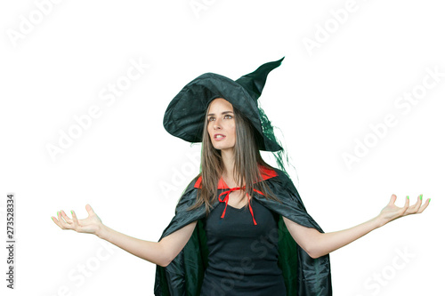 Fotografie, Tablou Happy gothic young woman in witch halloween costume with hat standing over white