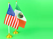 Leinwanddruck Bild - Tabletop flags of the United States and Mexico, who share a border and have a political relationship. The flags are together and on a green screen to allow for any background.