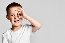 Boy Looking Through Hands, Making Binoculars