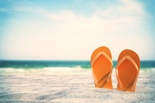 Orange Flip Flops On Beach