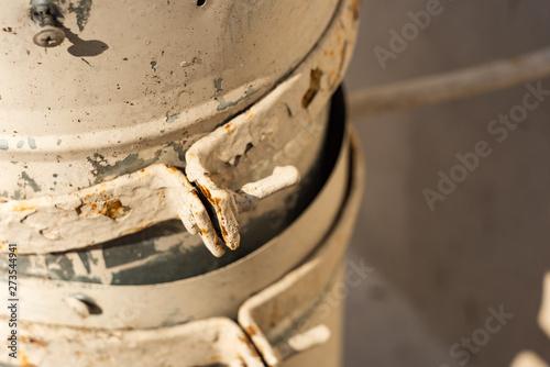 Valokuva  Metal bracket around a broken drainpipe