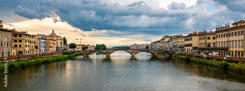 Panoramic view of the Ponte Alla Carraia, a bridge over the Arno River in the Tuscany region of Italy, as it passes through the city of Florence.