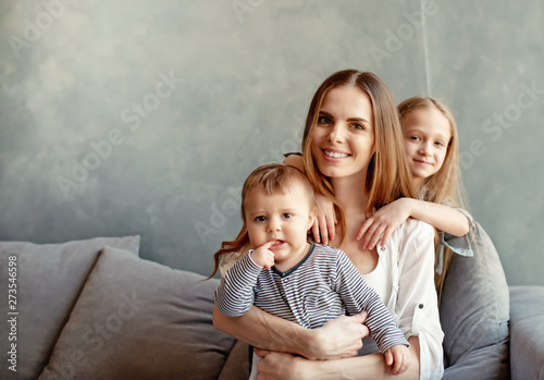 Fotografie, Obraz  Happy young mother with her children at home