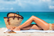 canvas print picture - Suntan beach vacation woman legs lying on sand towel relaxing on summer holidays. Body care sexy toned leg for cellulite or hair removal laser treatment concept.