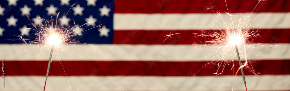 Fototapety, obrazy: Lit sparklers in front the American Flag for 4th of July celebration