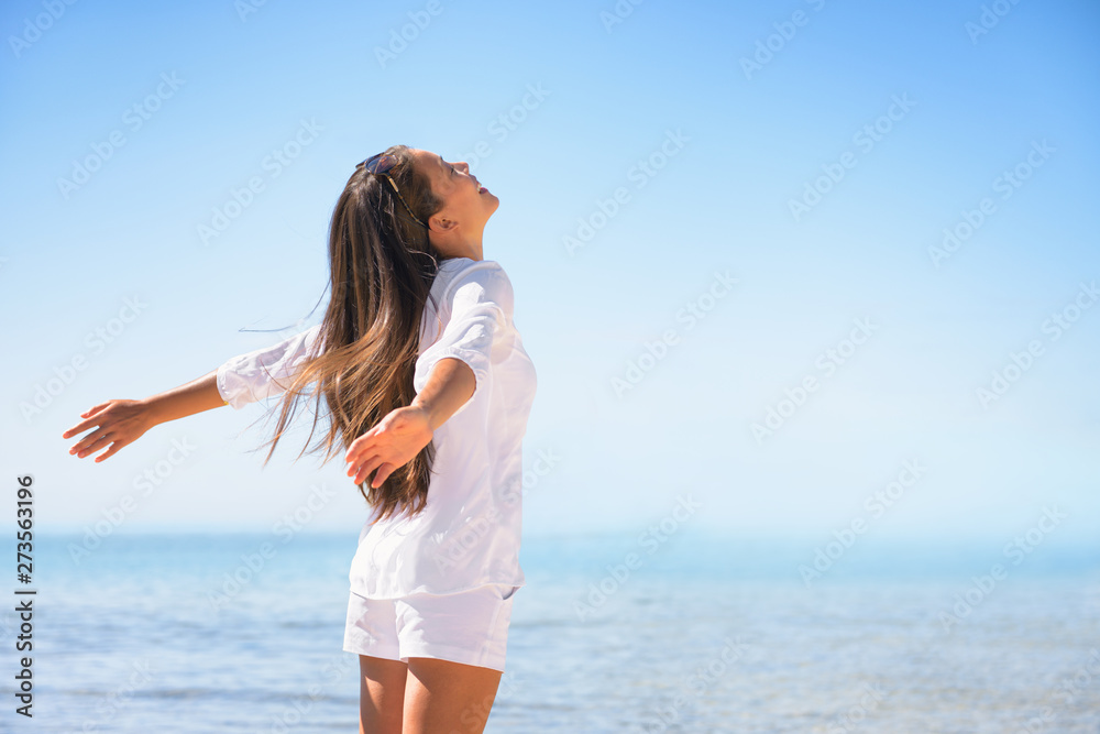 Fototapety, obrazy: Happy woman happiness emotion feeling free in summer sun lifestyle background. Joy and freedom concept. Asian girl with outstretched arms at beach ocean vacation travel.