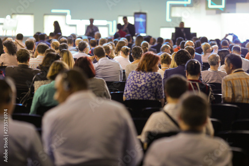 Fotomural  People attend a conference in a big hall.