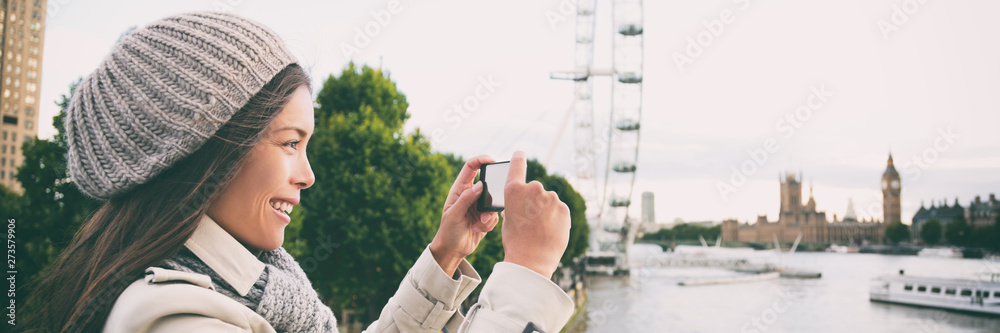 Fototapety, obrazy: London europe travel woman taking pictures with phone panorama banner. Tourist holding smartphone camera taking photos at Big Ben, Westminster Bridge, London, England