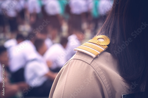Asian thai teachers in official uniform focus on golden stripe shoulder accessor Canvas Print