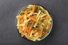 A Bowl With Uncooked Pasta Fusilli Tricolor