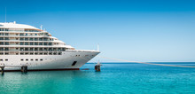 Side View And Bow Of A Docked Cruise Ship On A Summer Day With Clear Blue Sky