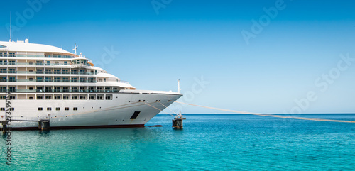 Fotografie, Obraz  Side view and bow of a docked cruise ship on a summer day with clear blue sky