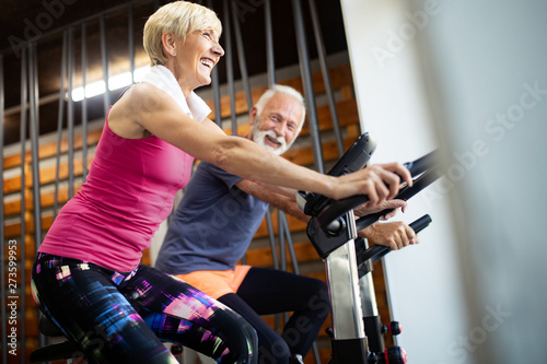 fototapeta na drzwi i meble Happy senior people doing exercises in gym to stay fit