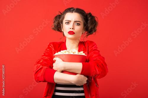 Emotional brunette girl holding a bucket of popcorn Canvas Print