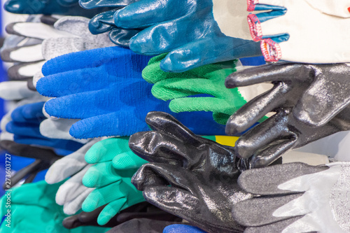 Fényképezés  Several different textile rubber gloves for workers for protection and safety