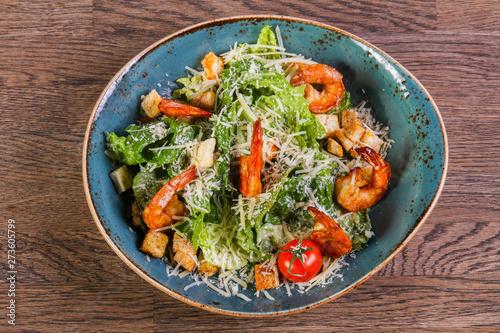 Fotografering  Caesar salad with shrimps