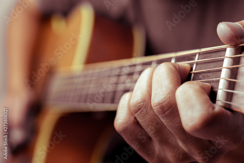Fotografia, Obraz  Musicians are playing acoustic guitar.