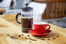 French Press Coffee Maker And Red Ceramic Coffee Cup On The Wooden Table, Coffee Brewing