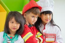 Three Kid Dress Up To Fireman ...